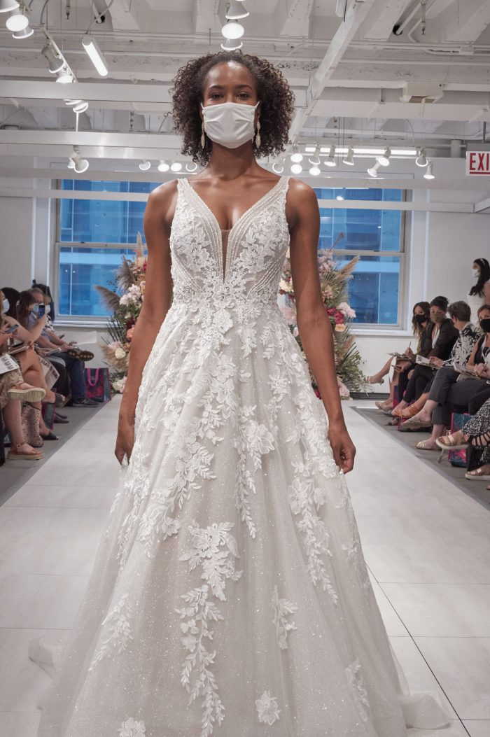 Model Wearing Geometric A-line Wedding Dress Called Essex at the 2021 Chicago Bridal Market