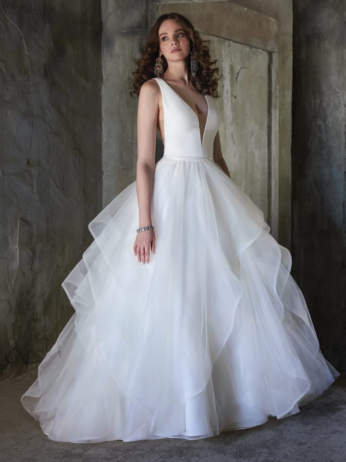 Bride Wearing Simple Ball Gown Wedding Dress Called Fatima by Maggie Sottero