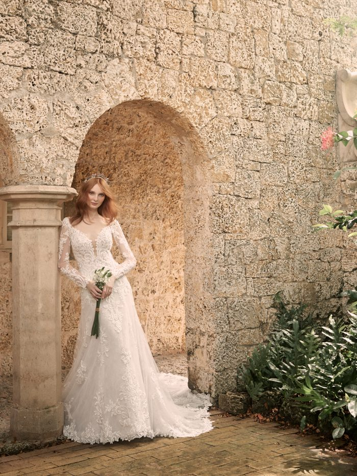 Model Wearing Sleeved Lace A-line Wedding Dress Called Johanna by Maggie Sottero