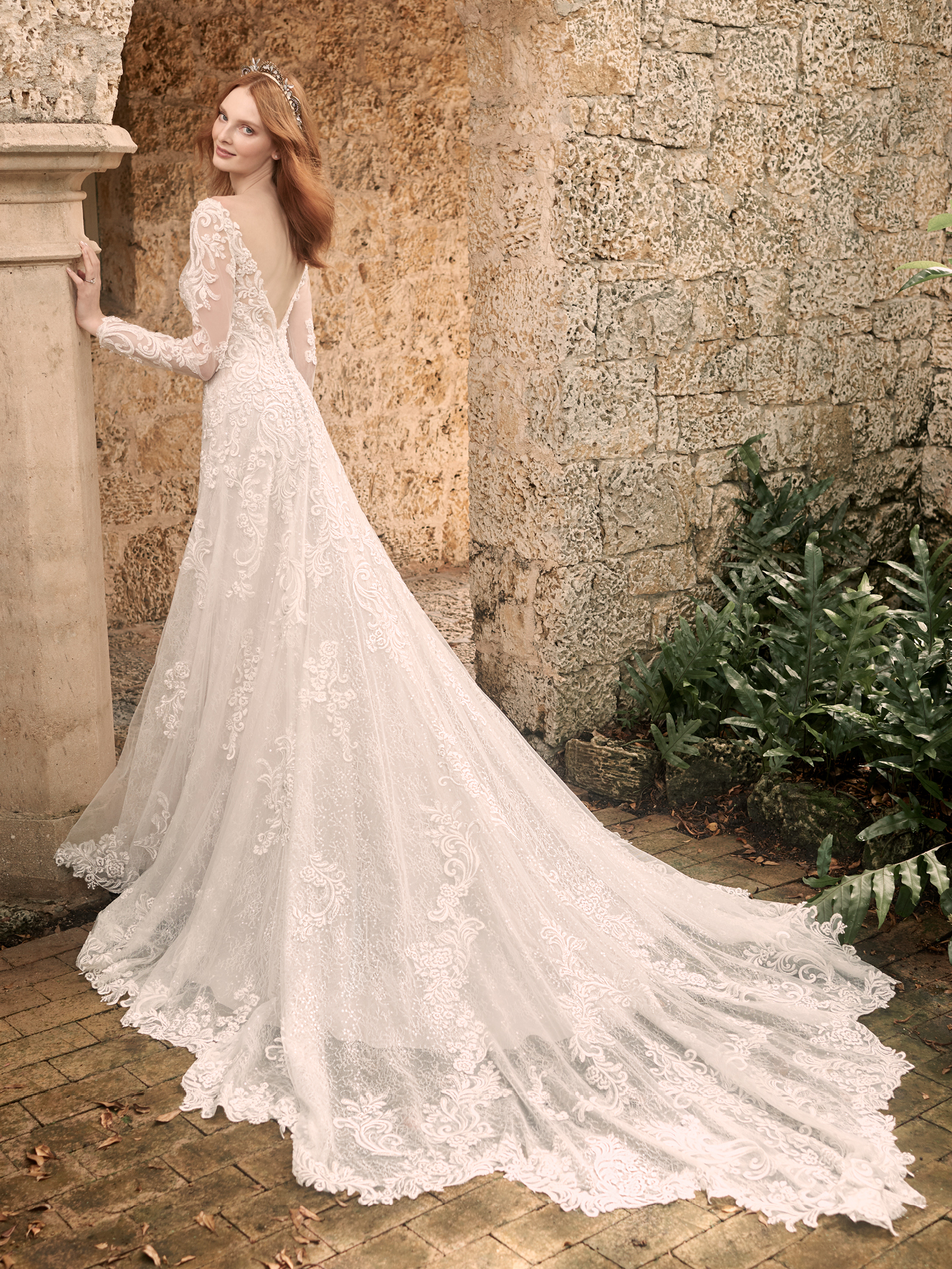Model Wearing Illusion Lace Sleeve Wedding Gown Called Johanna by Maggie Sottero
