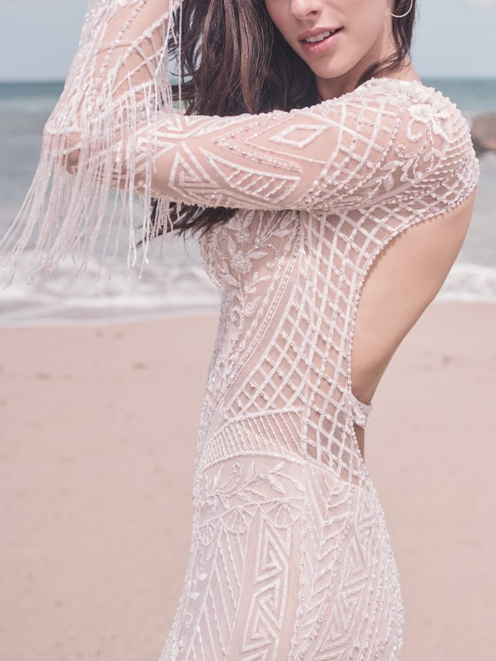 Bride on Beach Wearing Art Deco Wedding Dress with Fringe Called Andrew by Sottero and Midgley