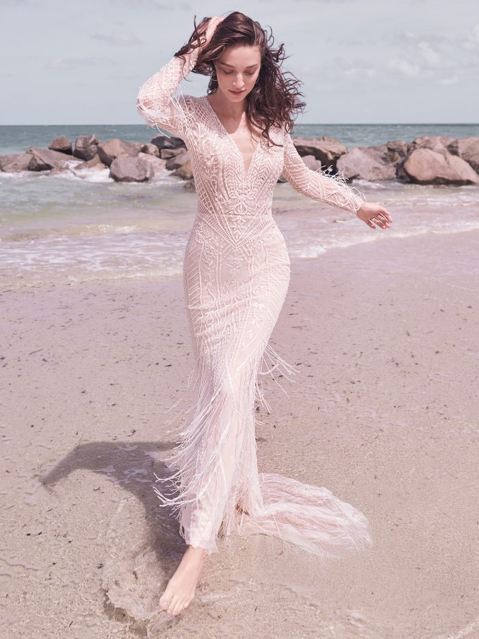 Model on Beach Wearing Art Deco Wedding Dress with Fringe Called Andrew by Sottero and Midgley
