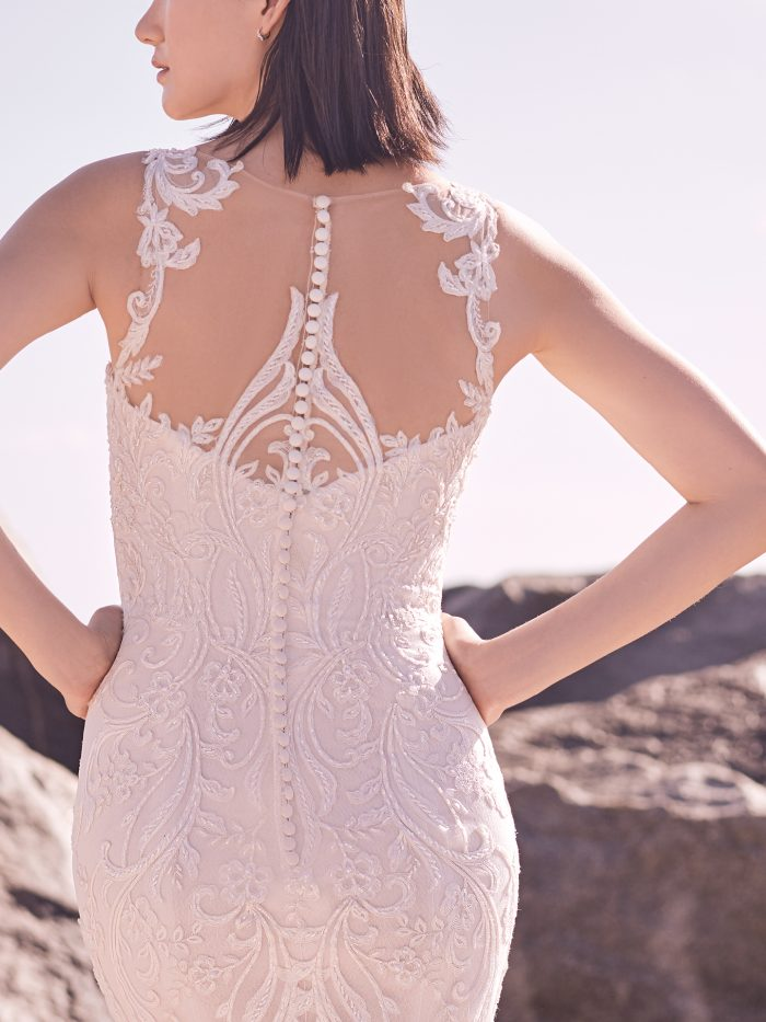 Model Wearing Elegant Lace Wedding Dress with Higher Back for Added Support by Sottero and Midgley