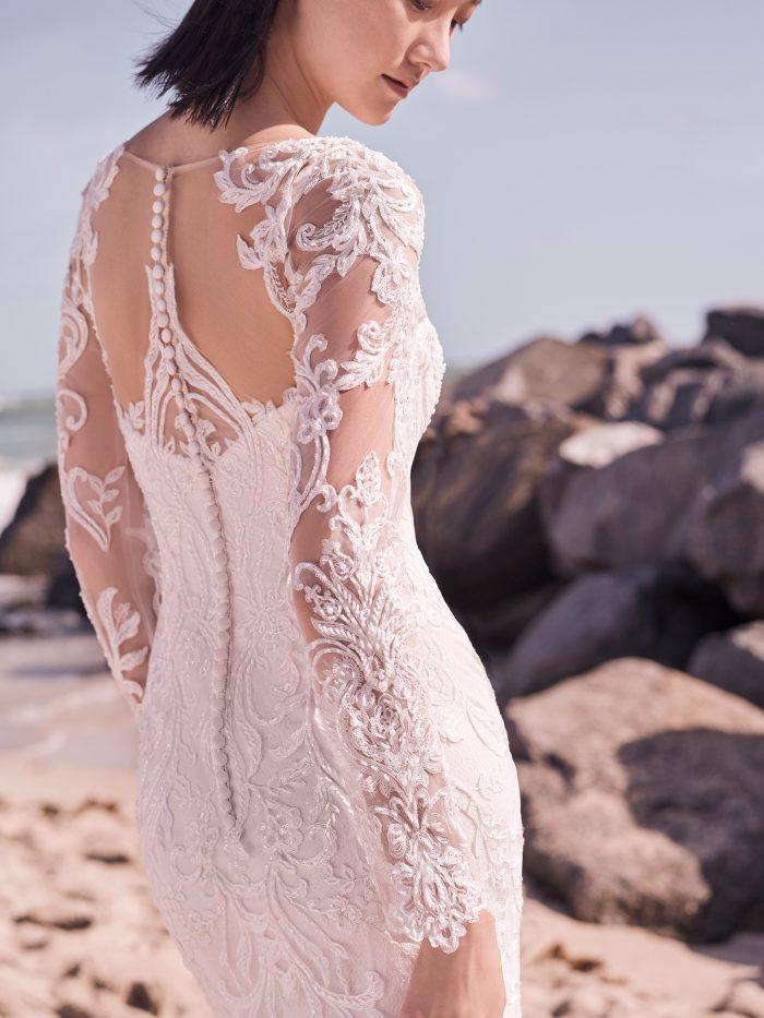 Bride on Beach Wearing Elegant Lace Long Sleeve Wedding Dress Called Hamilton Lynette by Sottero and Midgley