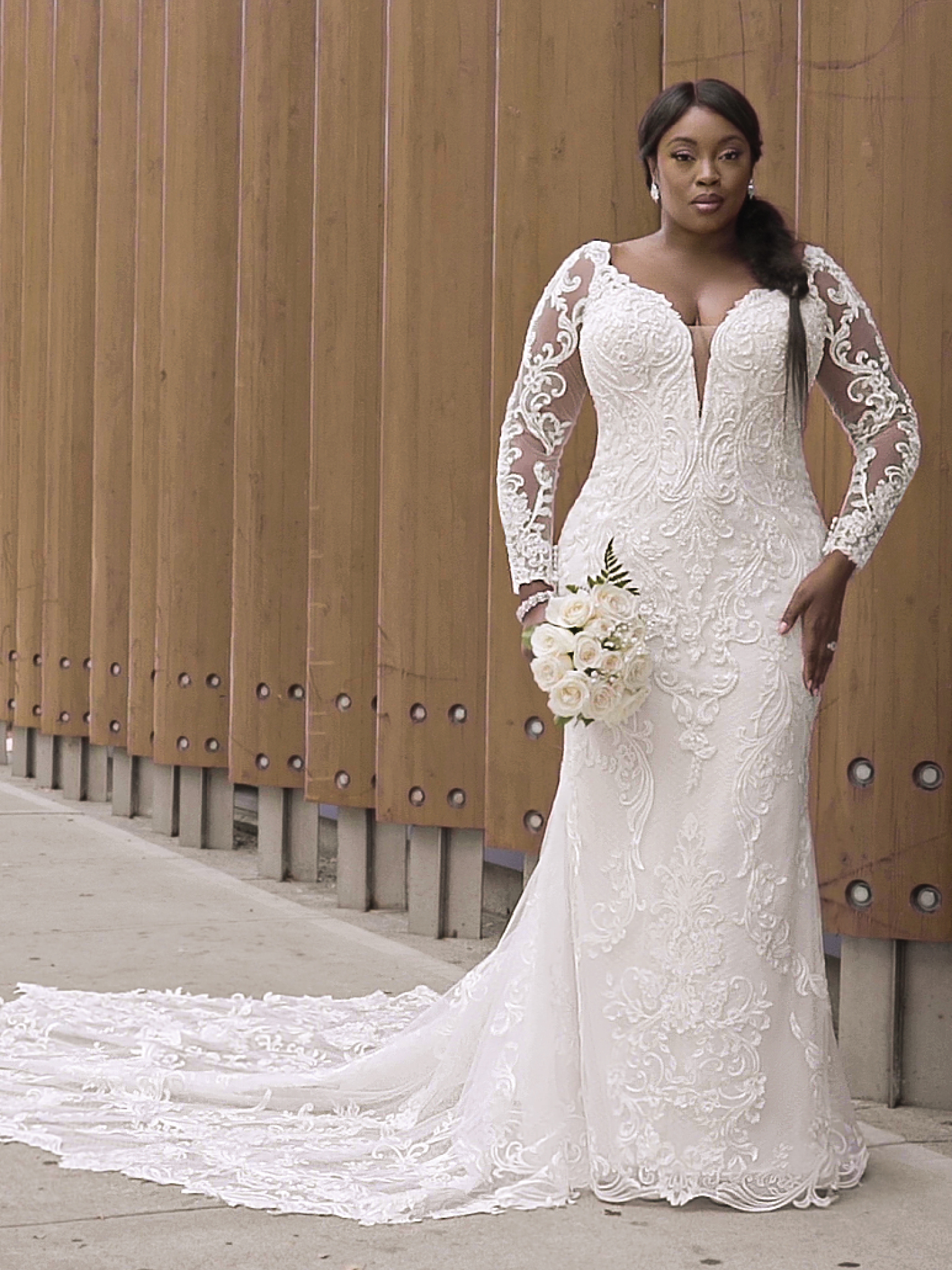Black Curvy Model Wearing Plus Size Wedding Gown Called Hamilton Lynette by Sottero and Midgley