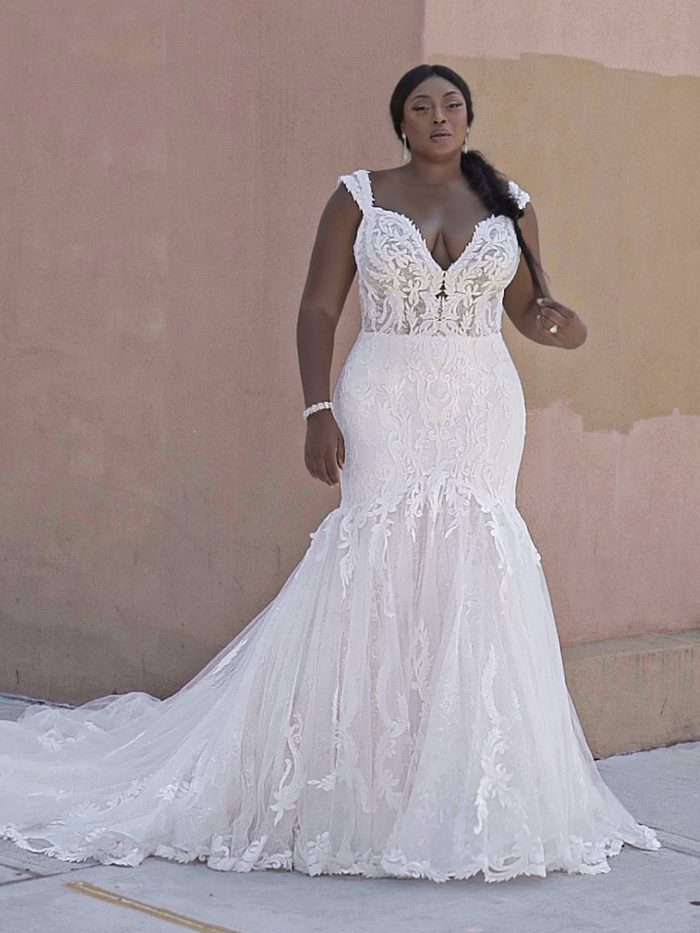 Black Model Wearing Plus Size Mermaid Lace Wedding Gown Called Joss by Sottero and Midgley