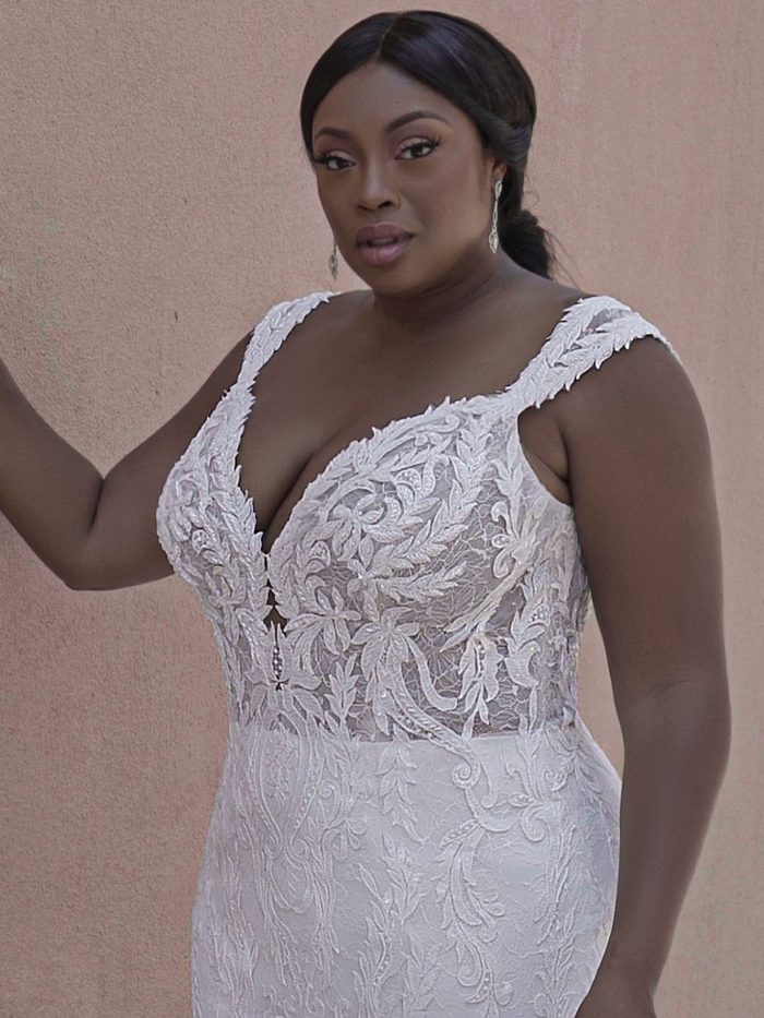 Black Plus Size Model Wearing Sexy Lace Mermaid Wedding Gown Joss by Sottero and Midgley
