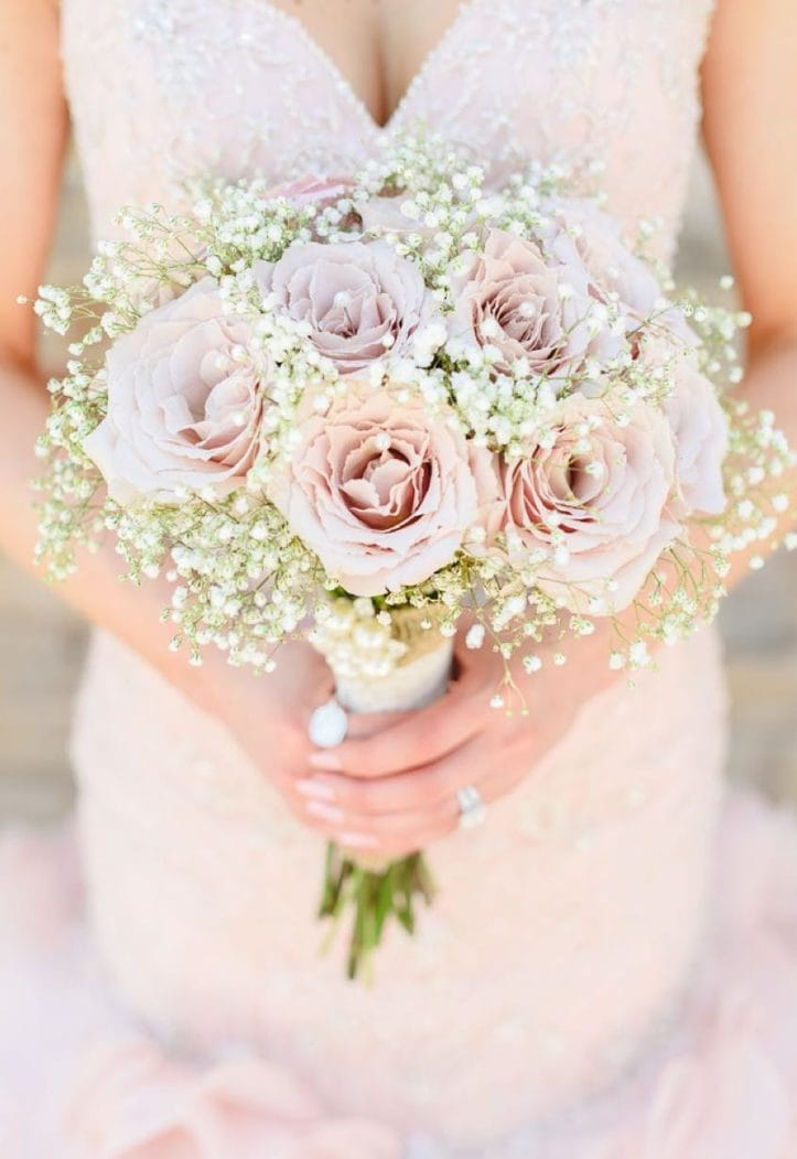 12 Reasons Not to Pass Up Roses for Your Big Day - Pink roses with Maggie Bride wearing Serencia