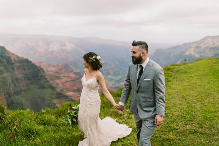 Bride and Groom Walking Along Gorgeous Mountains for Hawaii Destination Elopement