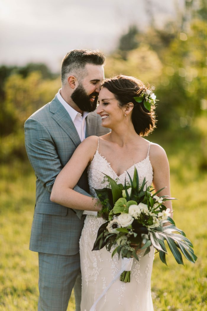 Groom Hugging Real Bride Wearing Flower Crown and Chignon with Elopement Wedding Dress Nola by Maggie Sottero