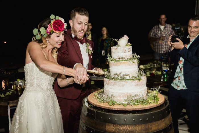 Groom with Real Bride Cutting Naked Wedding Cake at Festival Wedding