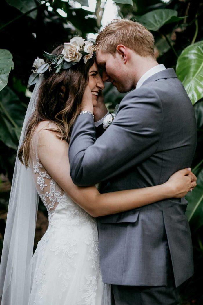 Groom Hugging Real Bride Wearing Boho Flower Crown and Floral Lace Wedding Dress Camille by Rebecca Ingram