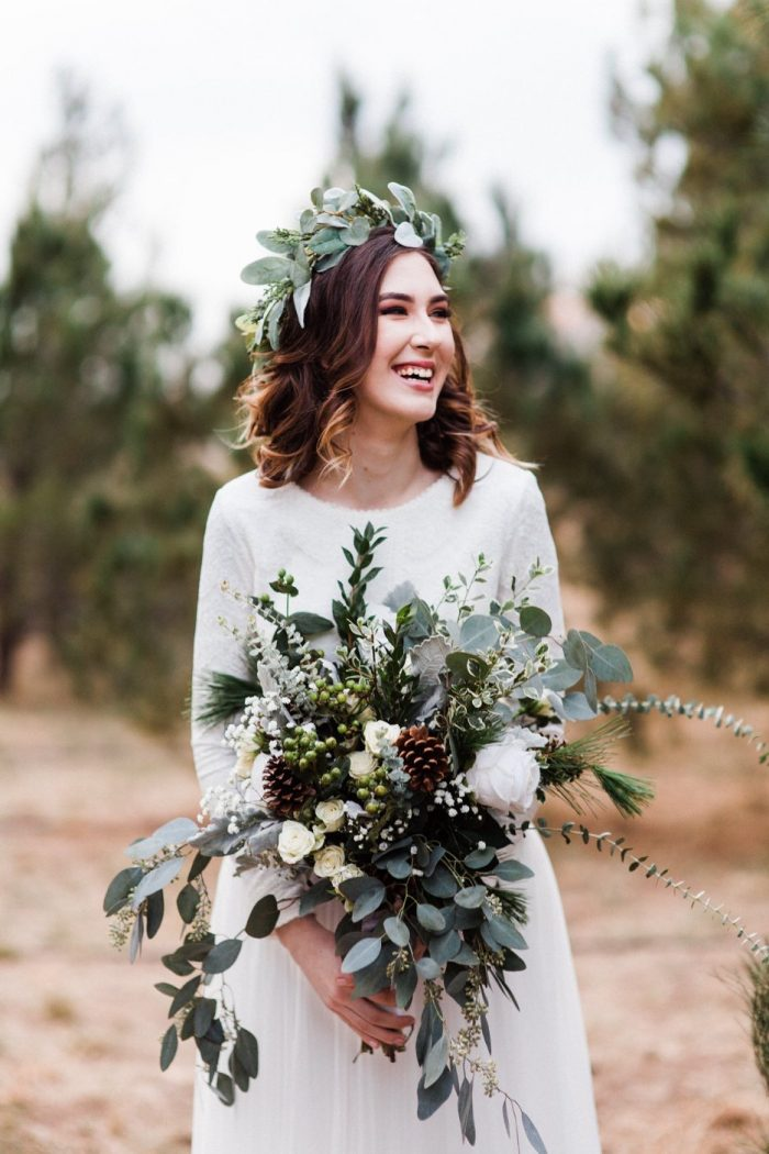 Real Bride Wearing Modest Wedding Dress and Holding Green Whimsical Wedding Bouquet