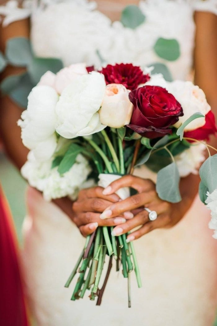 Bride Holding Bouquet of Red and White Roses