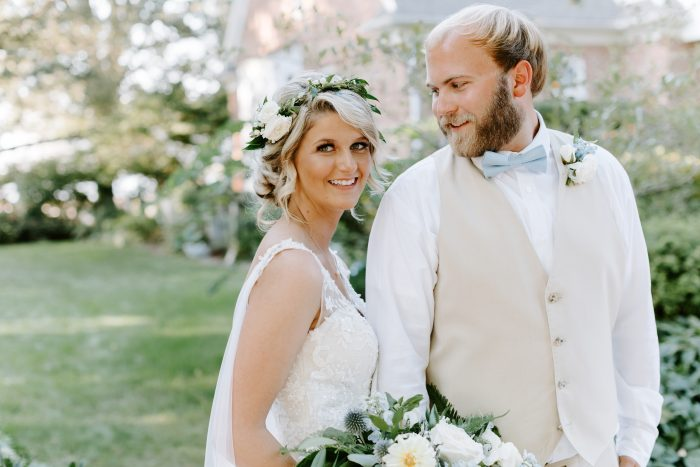 Groom with Bride Wearing Chignon with a Boho Flower Crown at Outdoor Wedding