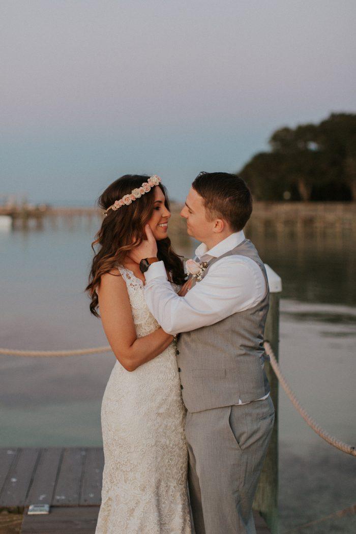 Groom Looking at Real Bride Wearing Beach Wedding Dress Called Hope by Rebecca Ingram