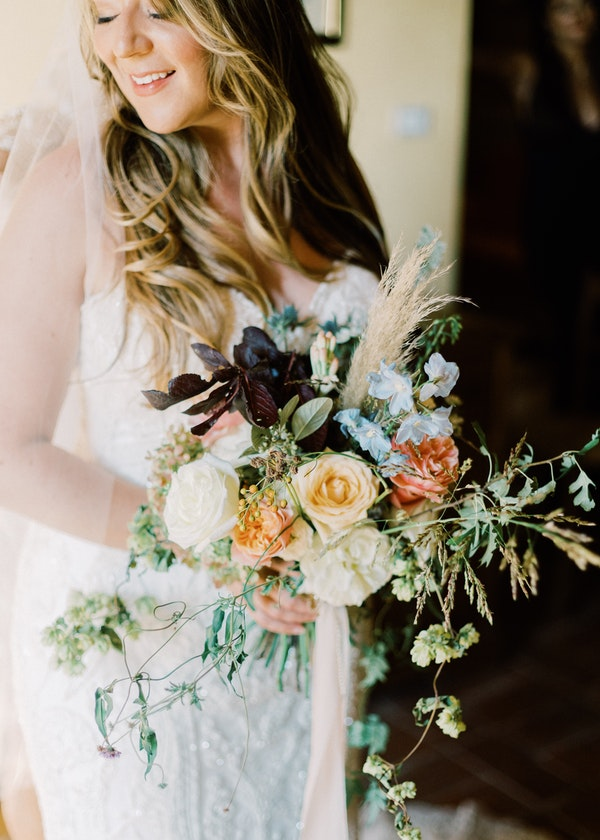 Real Bride Holding Bouquet of Roses in Tuscany Italy