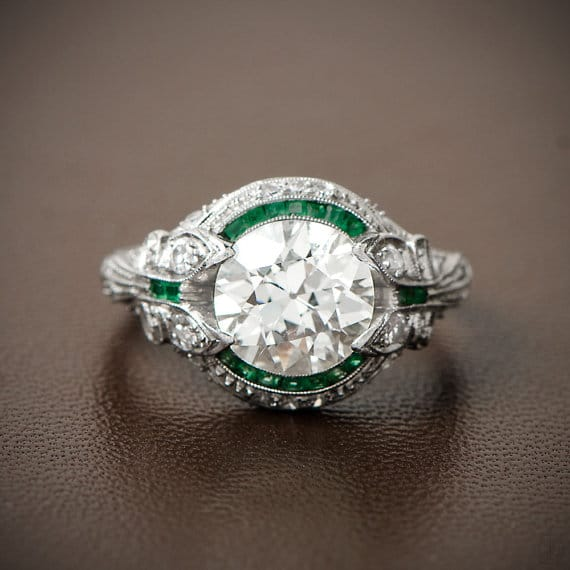 Rare and Pristine Art Deco Engagement Ring - Emerald and Diamond Halo - Bow Motif. Circa 1925