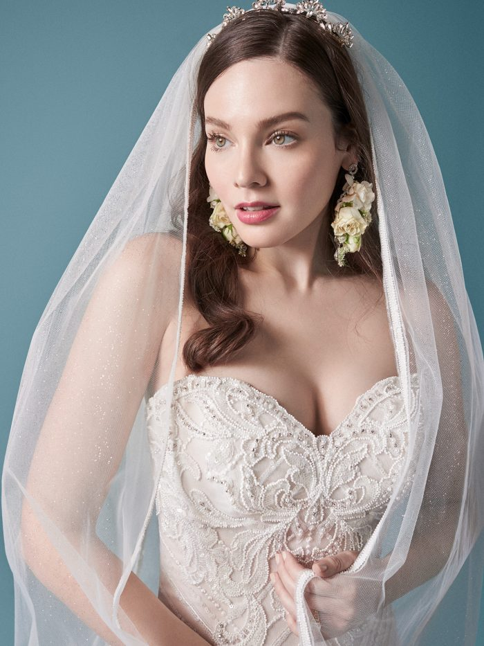 Model Wearing Tulle Trumpet Wedding Dress with Embroidered Lace Wedding Veil Called Gideon by Maggie Sottero
