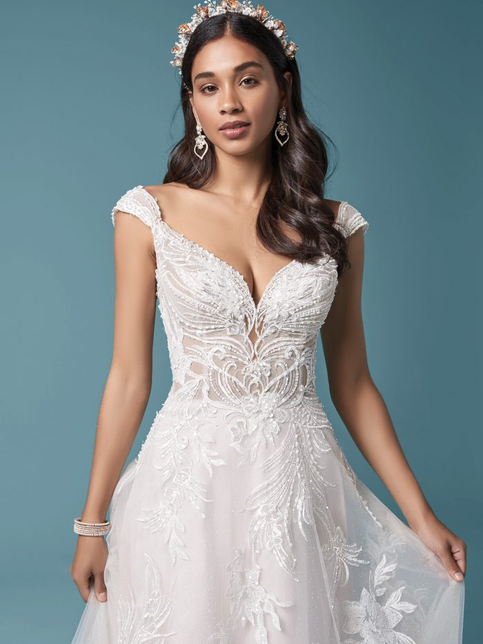 Model Wearing Unique Floral Lace A-line Wedding Dress Called Trina by Maggie Sottero