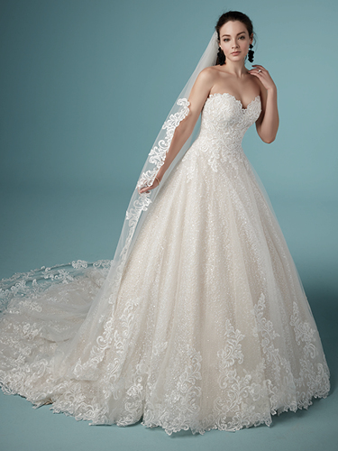 Model Wearing Lace Ball Gown Wedding Dress with Lace Embroidered Vintage Wedding Veil Called Tristyn by Maggie Sottero