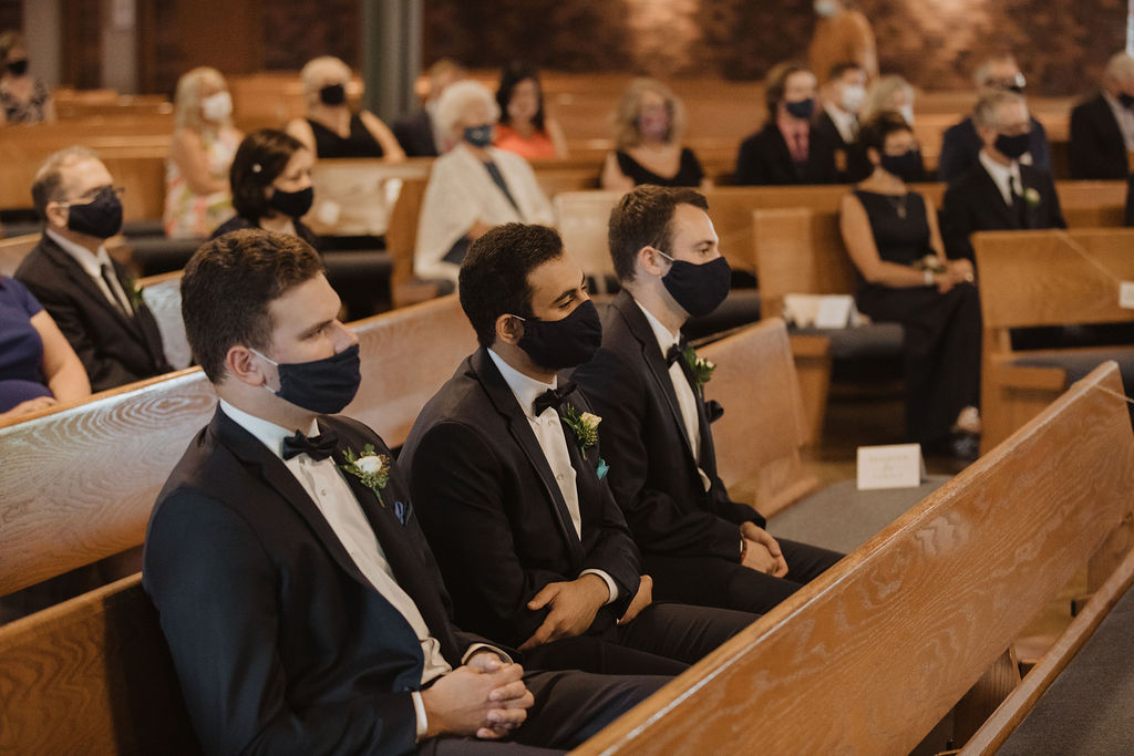 Wedding Guests at Church Wedding Ceremony Wearing Masks During COVID