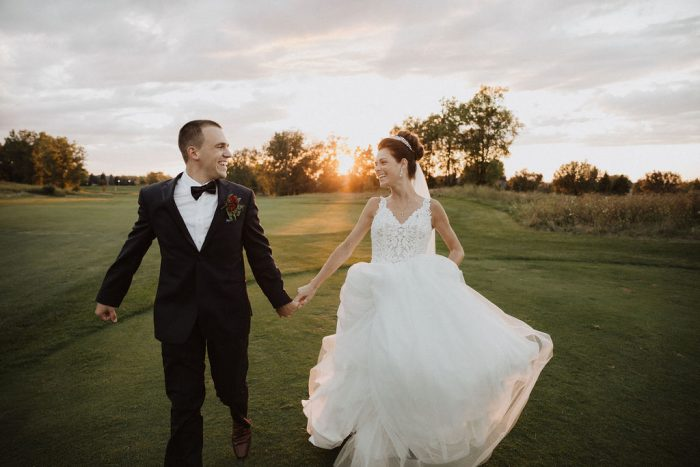 Groom Running with Bride Wearing Princess Wedding Gown Called Taylor Lynette by Maggie Sottero