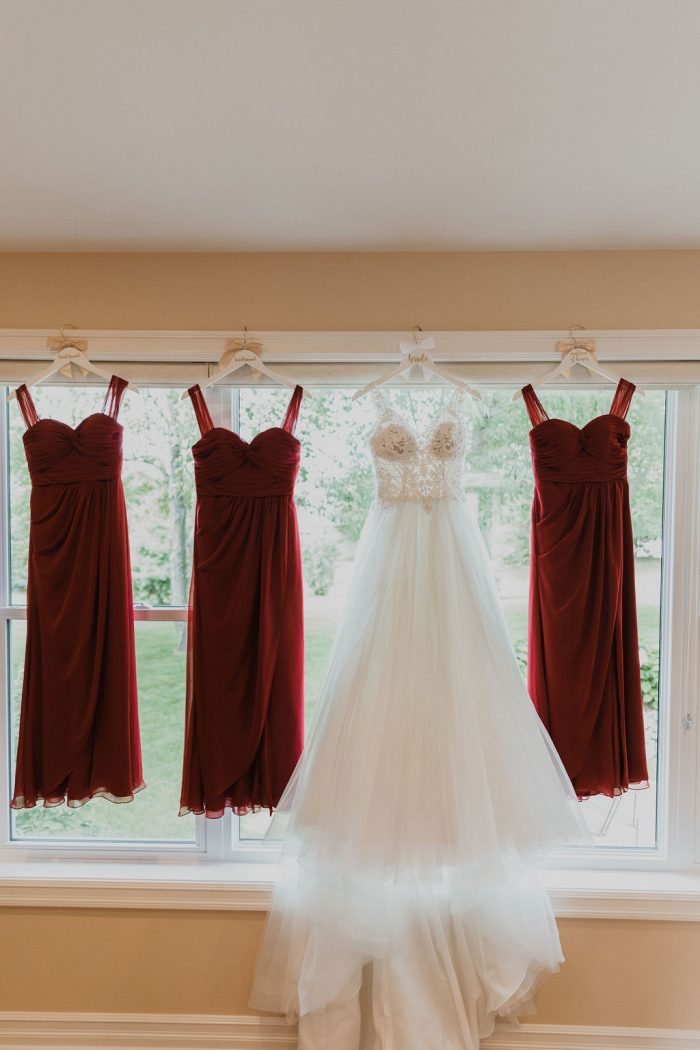 Red Bridesmaids Dresses with Ball Gown Wedding Dress by Maggie Sottero