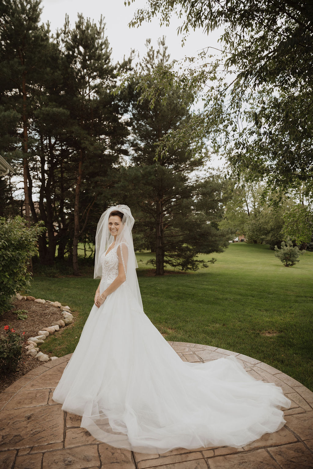 Bride Wearing Veil and Modern Princess Wedding Dress Called Taylor Lynette by Maggie Sottero