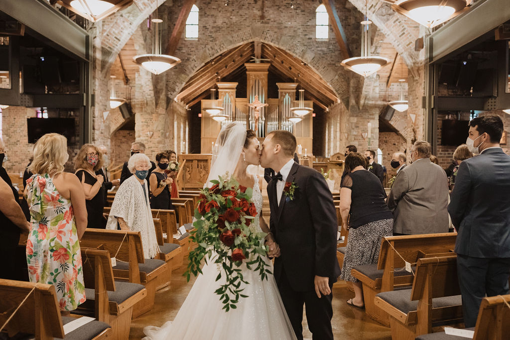 Bride and Groom Walking Down the Aisle After Getting Married in Church