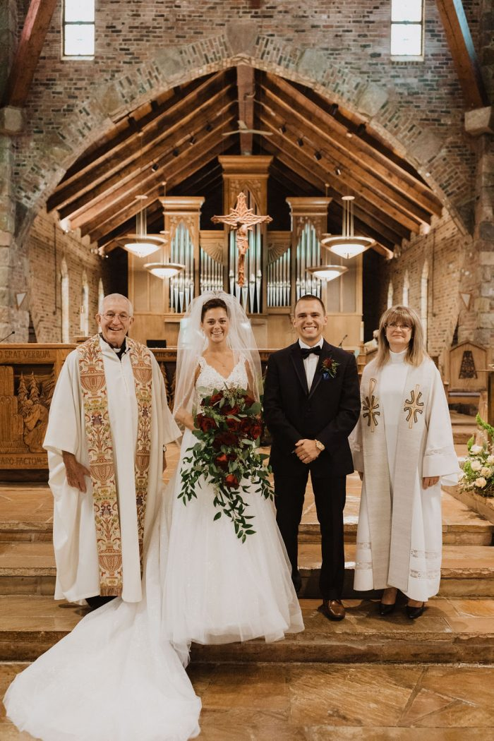 Bride and Groom Standing with Priest and Pastor at Ceremony