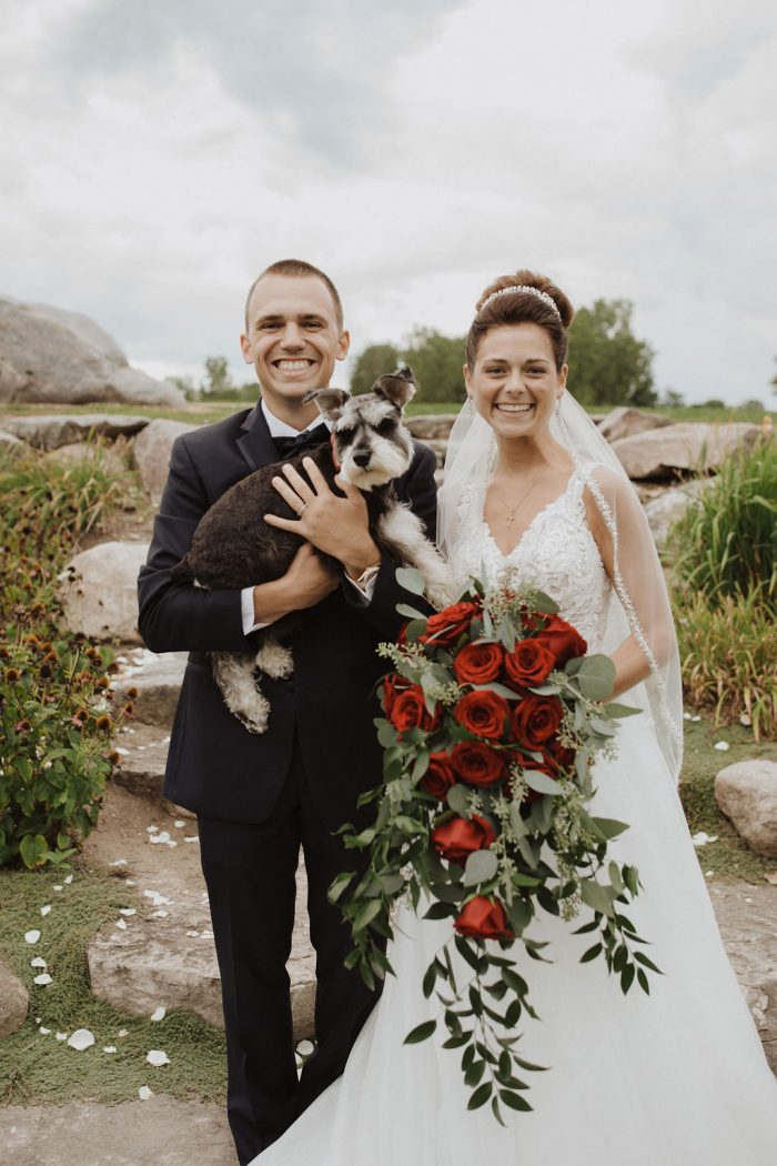 Bride and Groom Standing with Their Dog