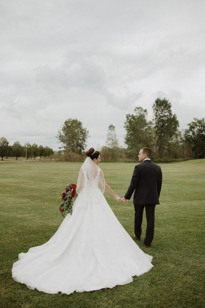Groom Spinning Bride Wearing Ball Gown Wedding Dress Called Taylor Lynette by Maggie Sottero