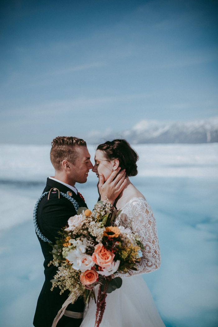 Groom with Real Bride Wearing Lace Ball Gown Wedding Dress Called Mallory Dawn by Maggie Sottero on Glacier in Alaska
