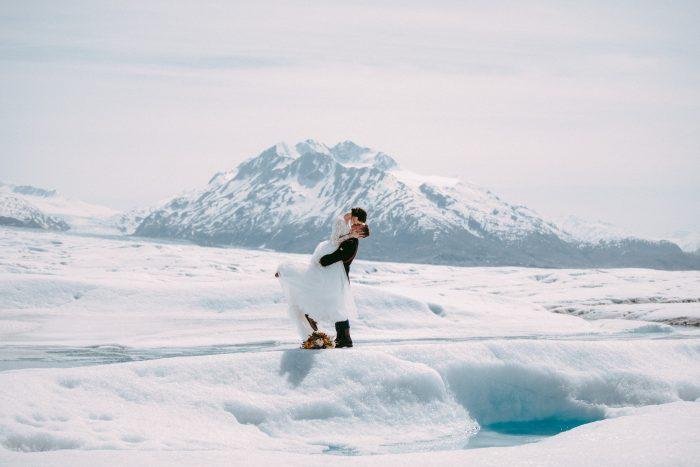 Groom Kissing Real Bride in Destination Elopement in Alaska in the Snow
