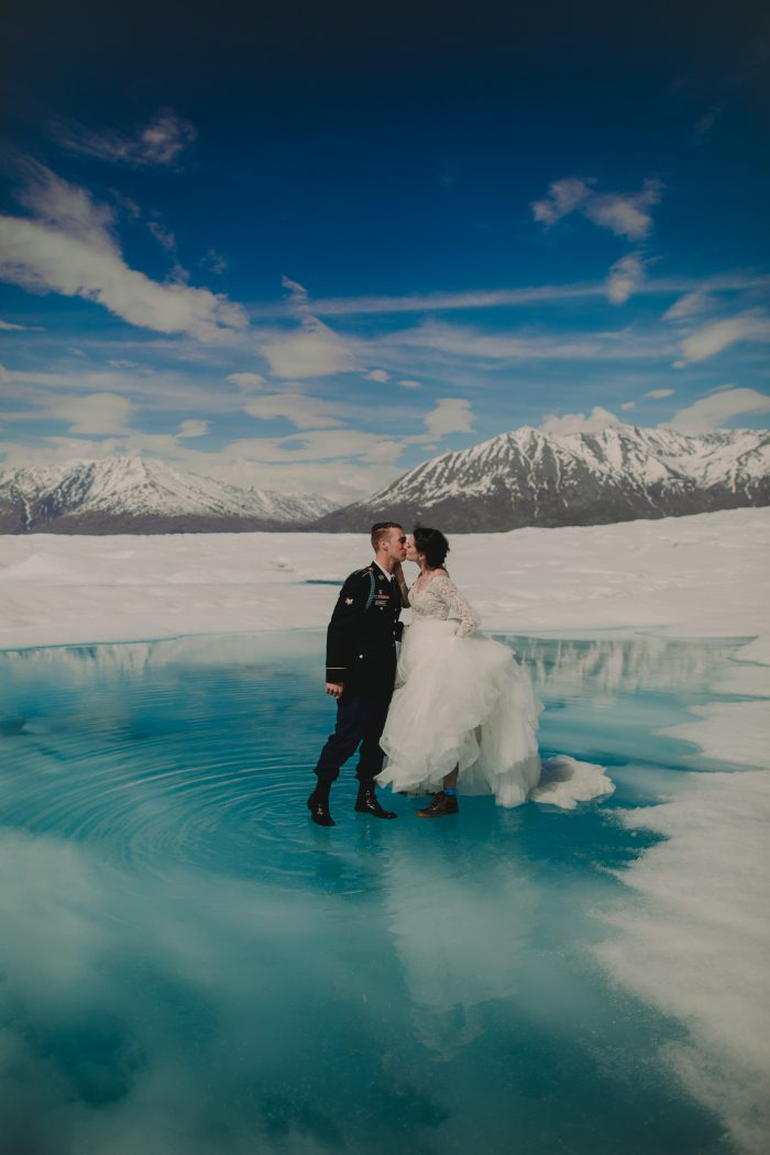 Groom with Real Bride Getting Married on Glacier in Alaska in Romantic Destination Wedding