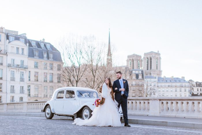 Groom with Real Bride in Paris France Wearing Layered Ball Gown Wedding Dress by Sottero and Midgley