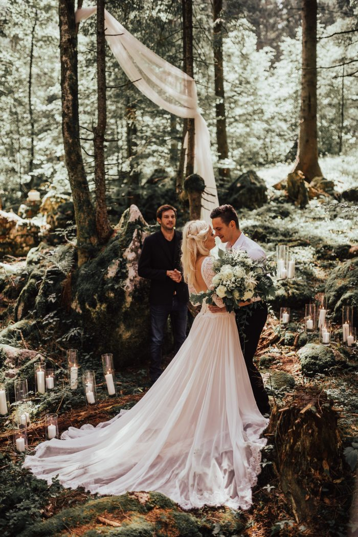 Groom with Bride at Mountain Resort in Slovenia for Romantic Destination Wedding