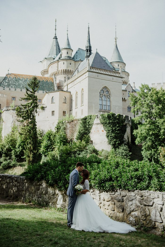 Groom Kissing Real Bride at Castle in Slovakia at Destination Wedding