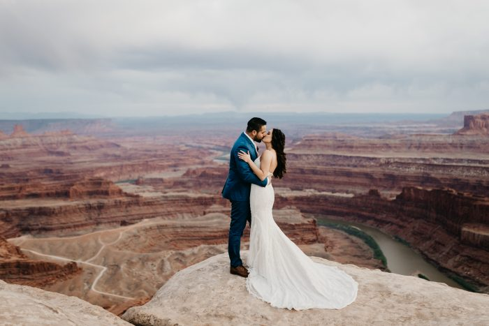 Groom Kissing Real Bride in Maggie Sottero Wedding Dress at Dead Horse Point in Moab Utah