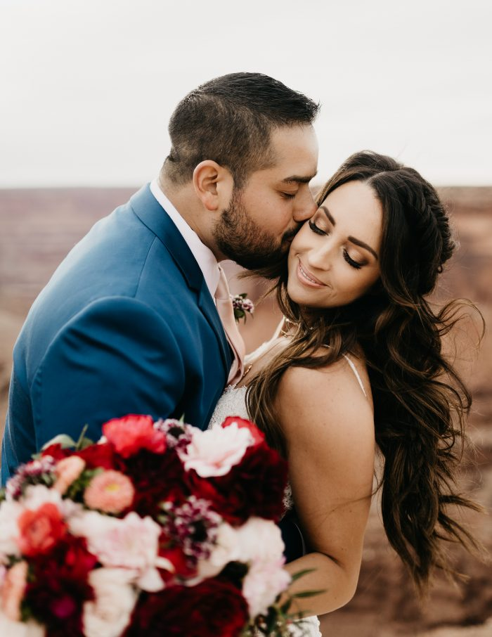 Groom with Real Bride Wearing Sheath Wedding Dress Called Narissa by Sottero and Midgley at Dead Horse Point in Moab Utah