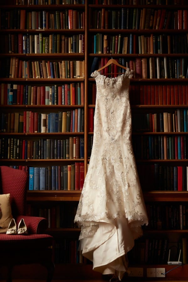 Wedding Dress by Maggie Sottero hanging in Library at Vintage Wedding