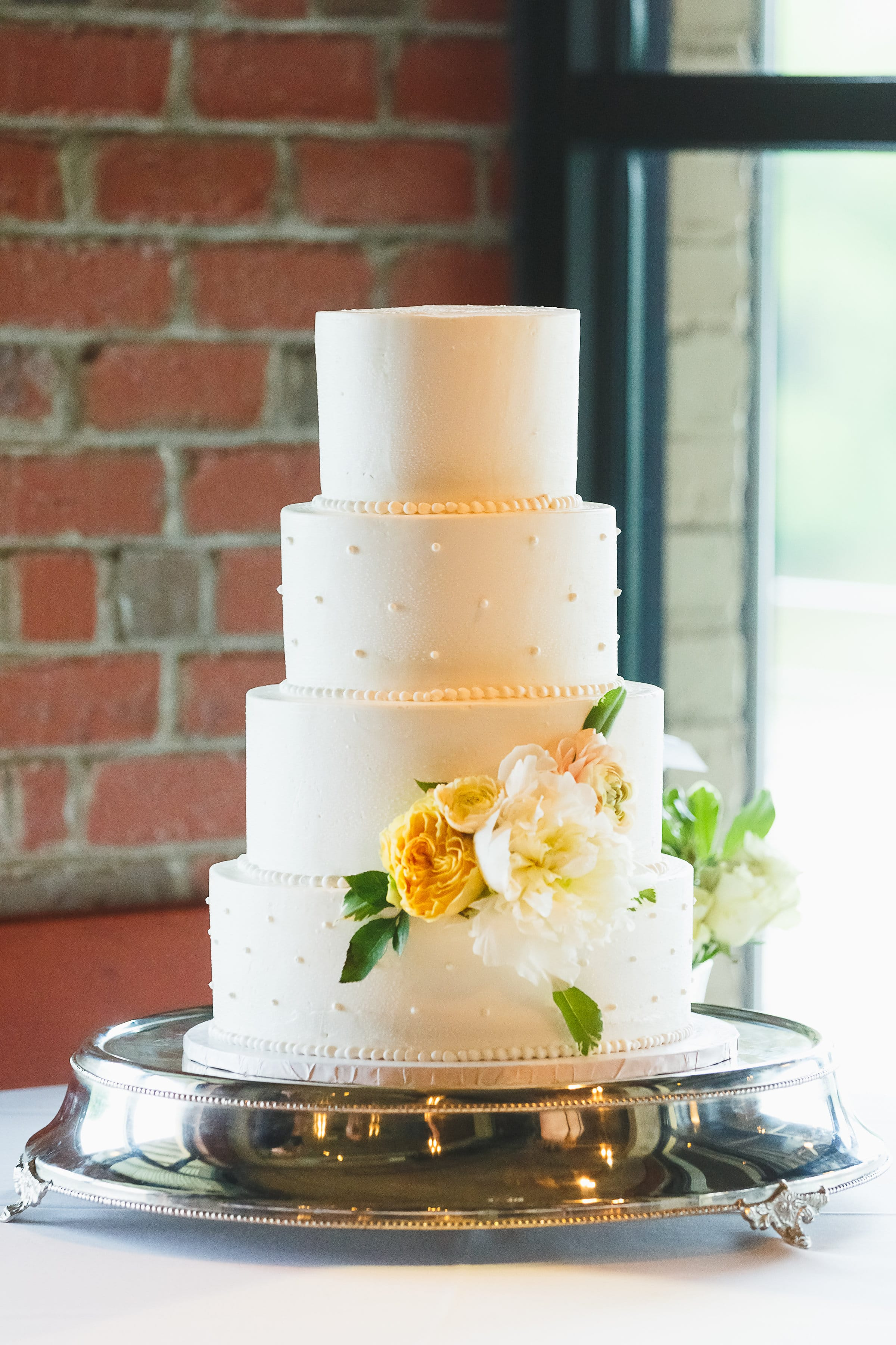 White Wedding Cake with Pearls at Wedding