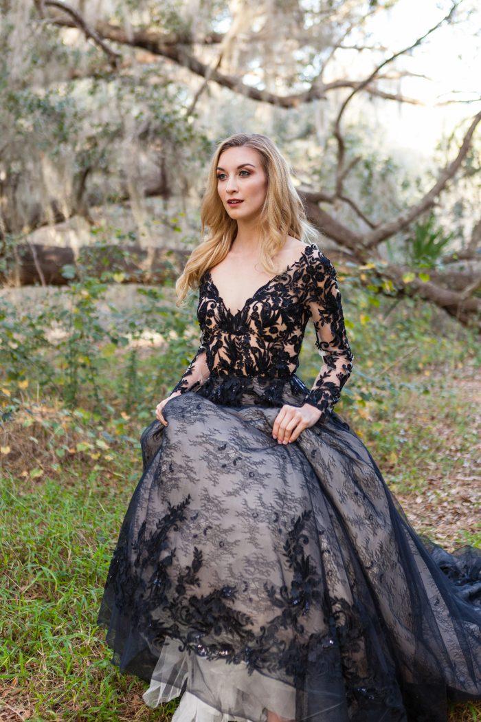 Bride walking outdoors wearing Zander Black Wedding Dress by Sottero and Midgley