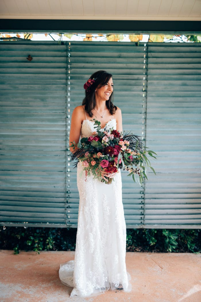 Bride holding colorful wedding bouquet with roses
