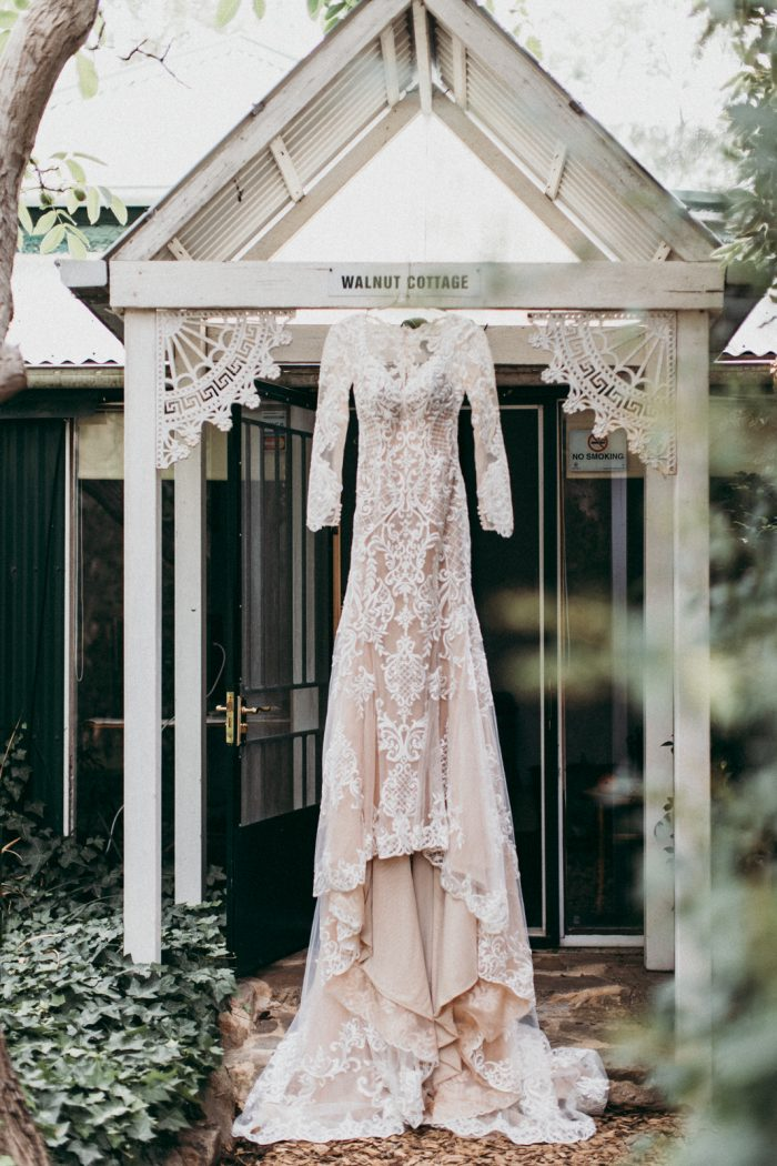 Long Sleeve Lace Wedding Dress Hanging from Doorway Called Dakota by Sottero and Midgley