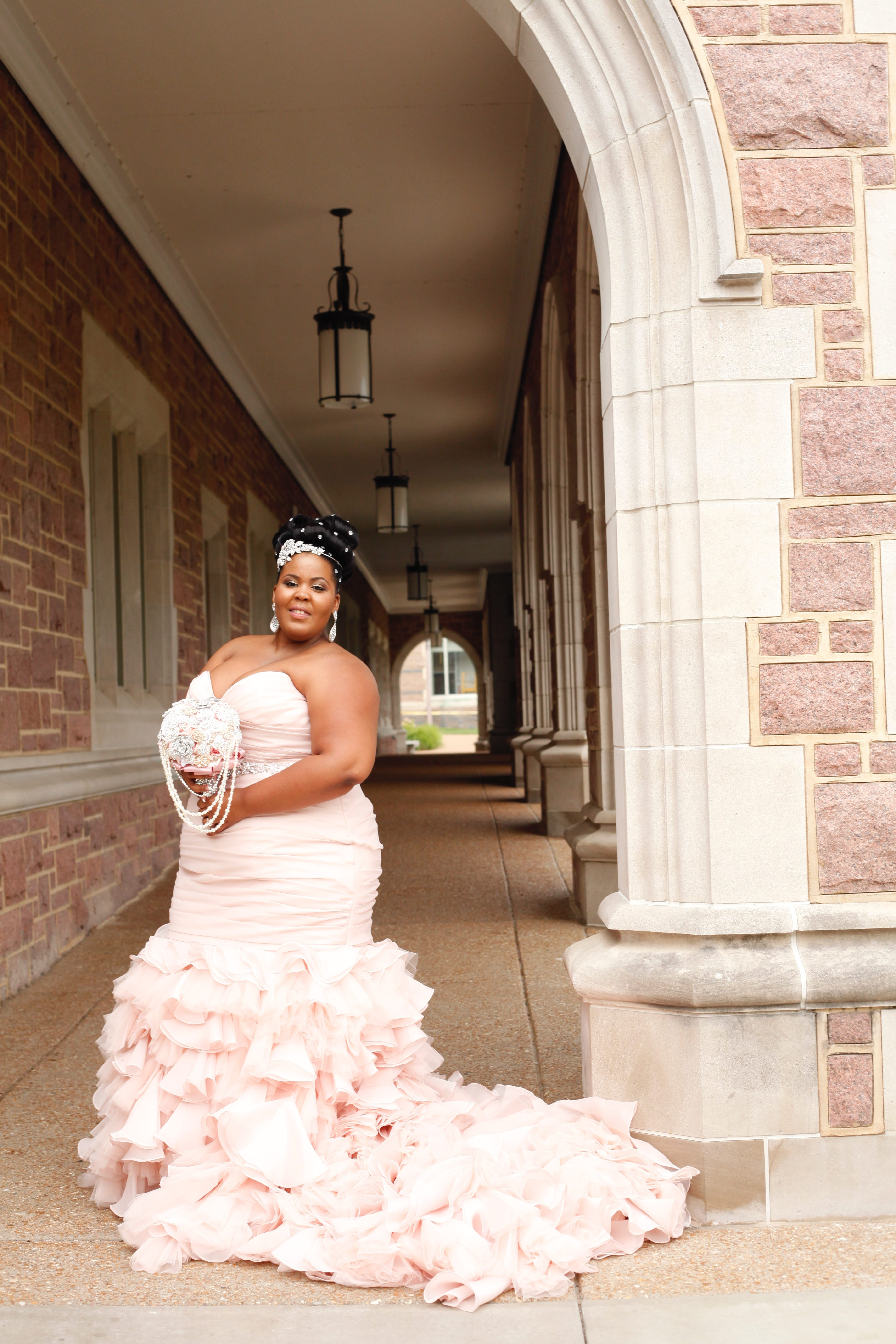 Maggie Bride Whitney wearing Divina in blush by Maggie Sottero