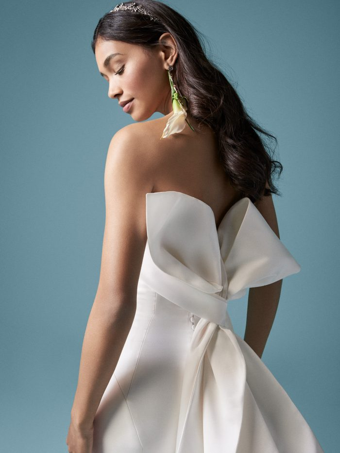 Model Wearing Unique Satin Bridal Dress with Bow in Back Called Mitchel by Maggie Sottero