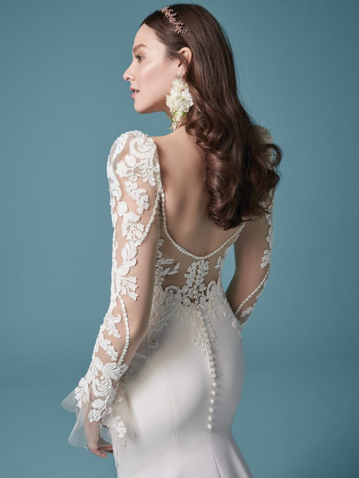 Model Wearing Unique Crepe Sheath Wedding Dress Called Nikki Made by Maggie Sottero