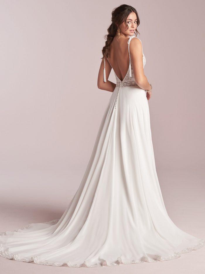 Model Wearing Maggie Sottero Wedding Dress Under $1000 Called Jolie